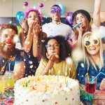 Things to do on your birthday: a group of friends with cake and balloons at a party