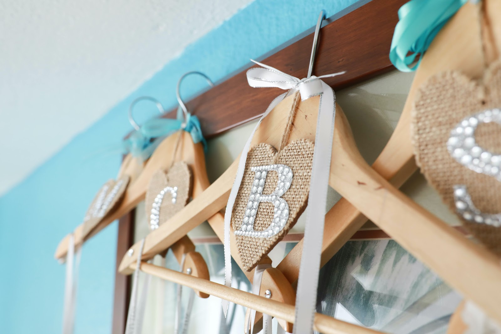 Personalized wooden hangers with silk bows