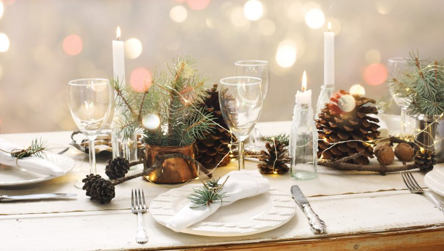 Holiday party ideas: A table setting with pine cones and fir tree branches