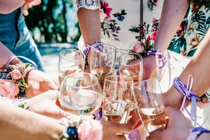 Bachelorette party ideas: Women cheers with wine glasses at a wine tasting
