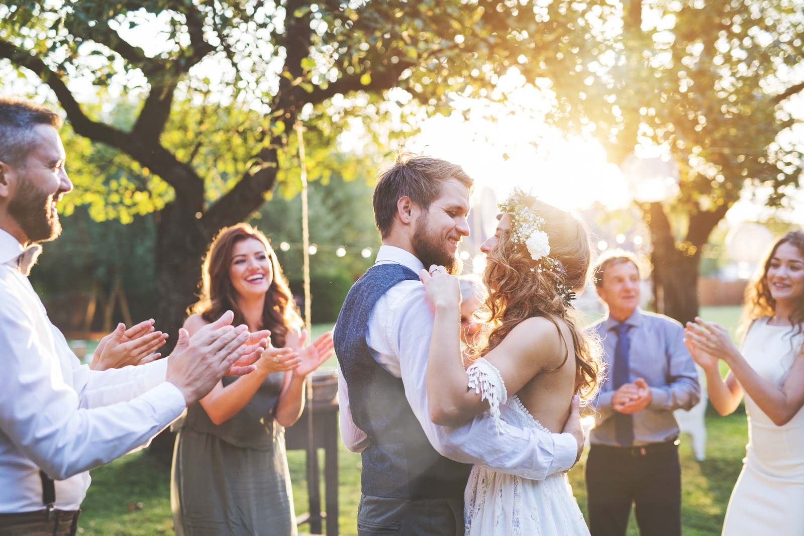 minimony: Newlywed couple dancing while surrounded by smiling guests