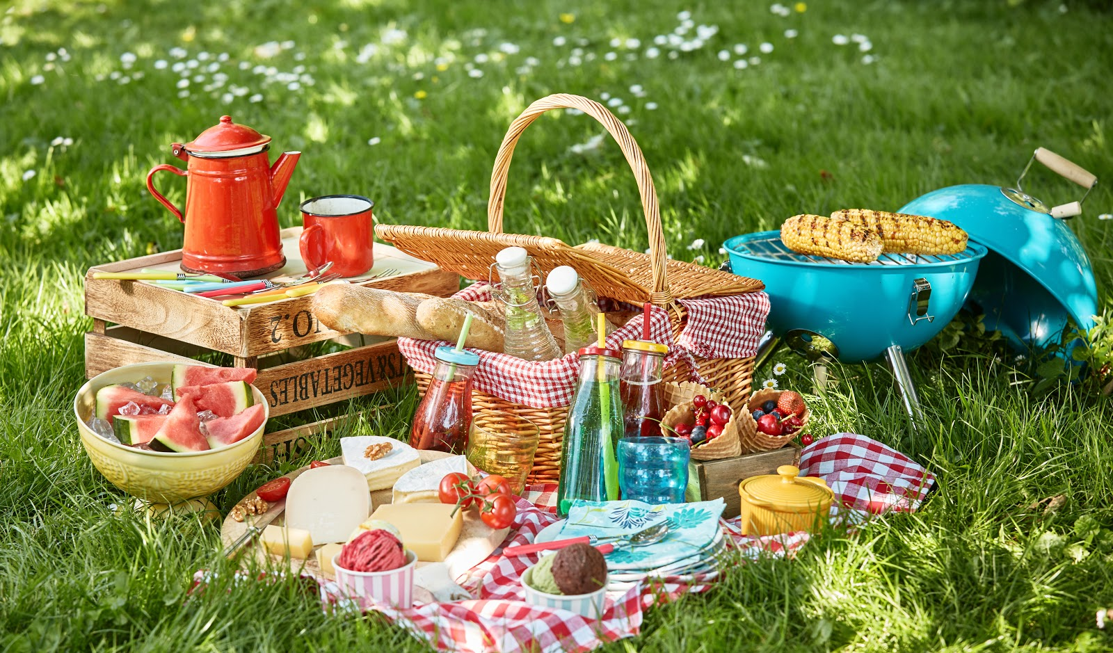 An array of picnic food on the grass