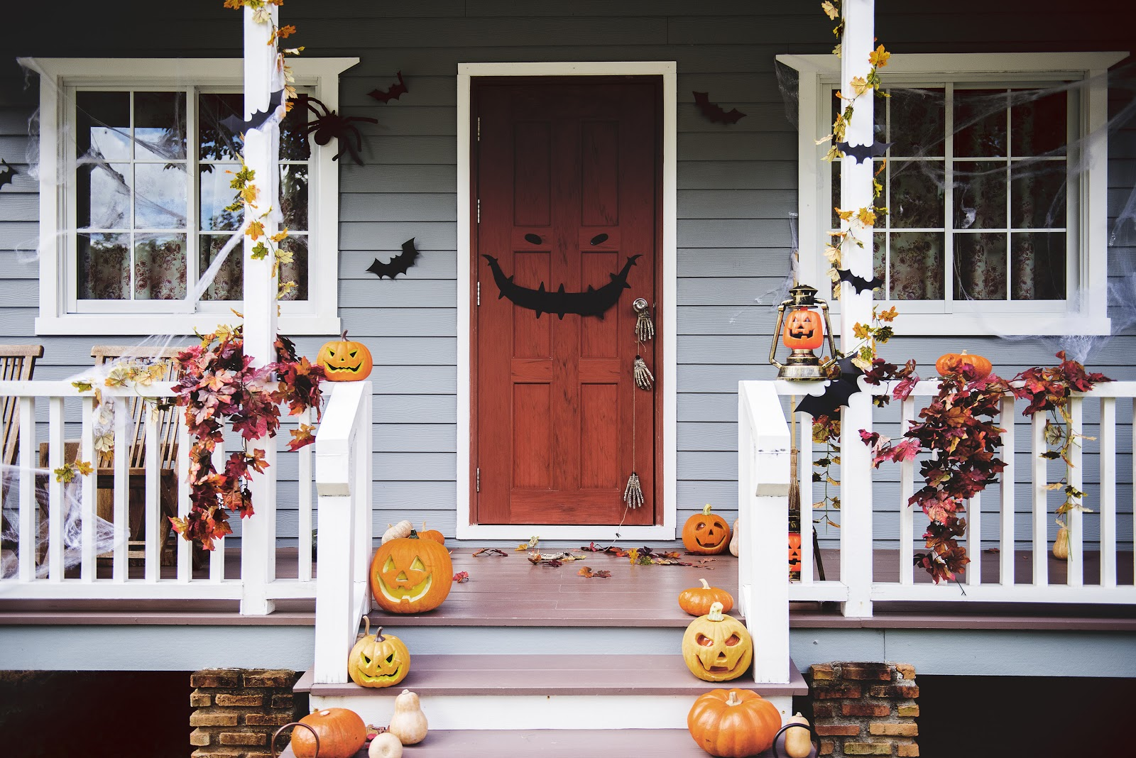 The front of a house is adorned with Halloween decorations.