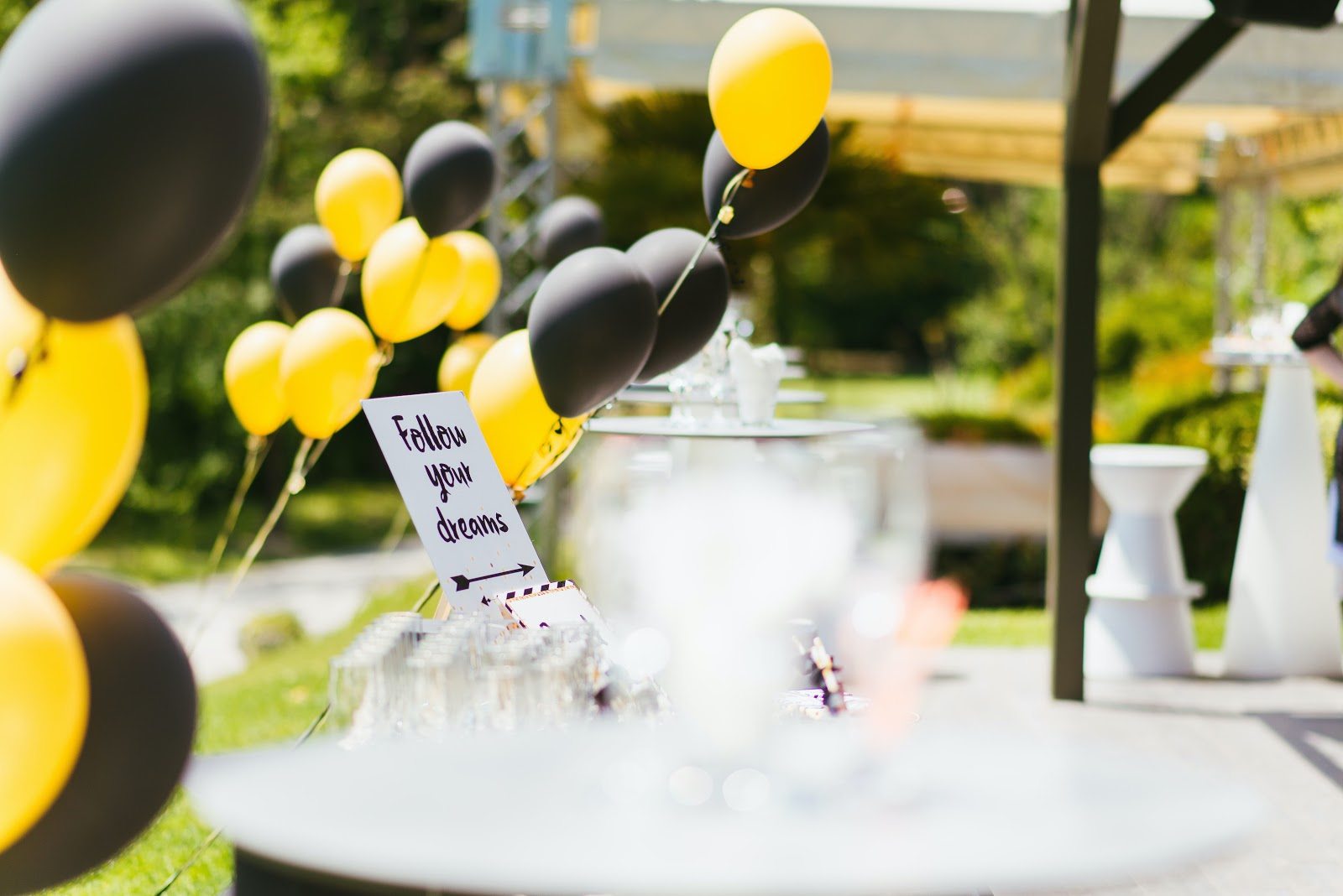 Black and yellow balloon on a party table