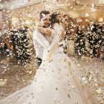 Wedding reception ideas: A bride and groom on the dance floor while confetti rains down around them