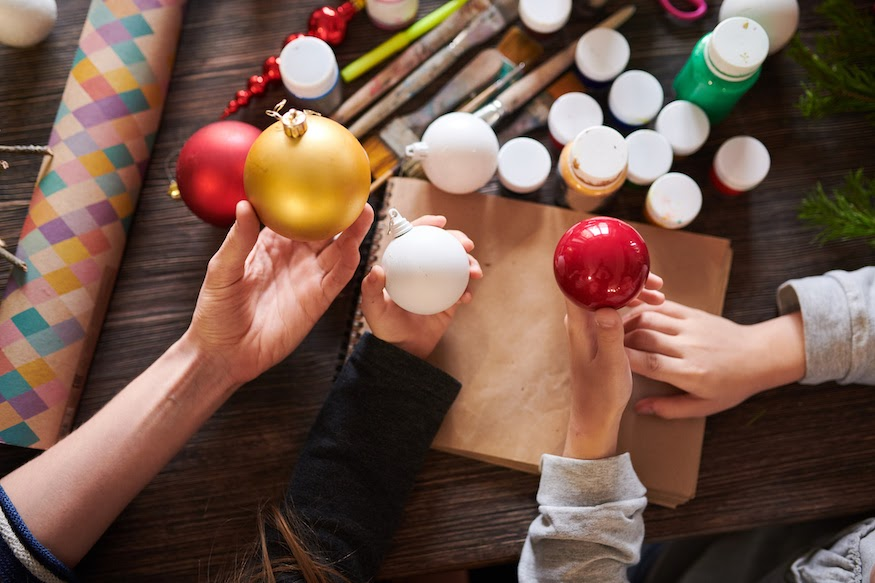 Hands decorate ornaments as part of their holiday party games