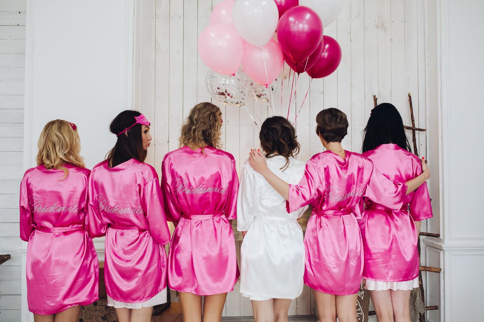 Bridal shower invitations: Bridesmaids in pink robe