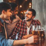 Bachelor party ideas: Three guy friends in an industrial pub
