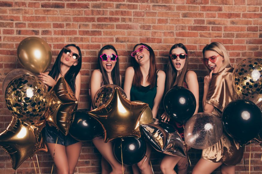 Bachelorette party ideas: A bridal party with balloons and festive sunglasses