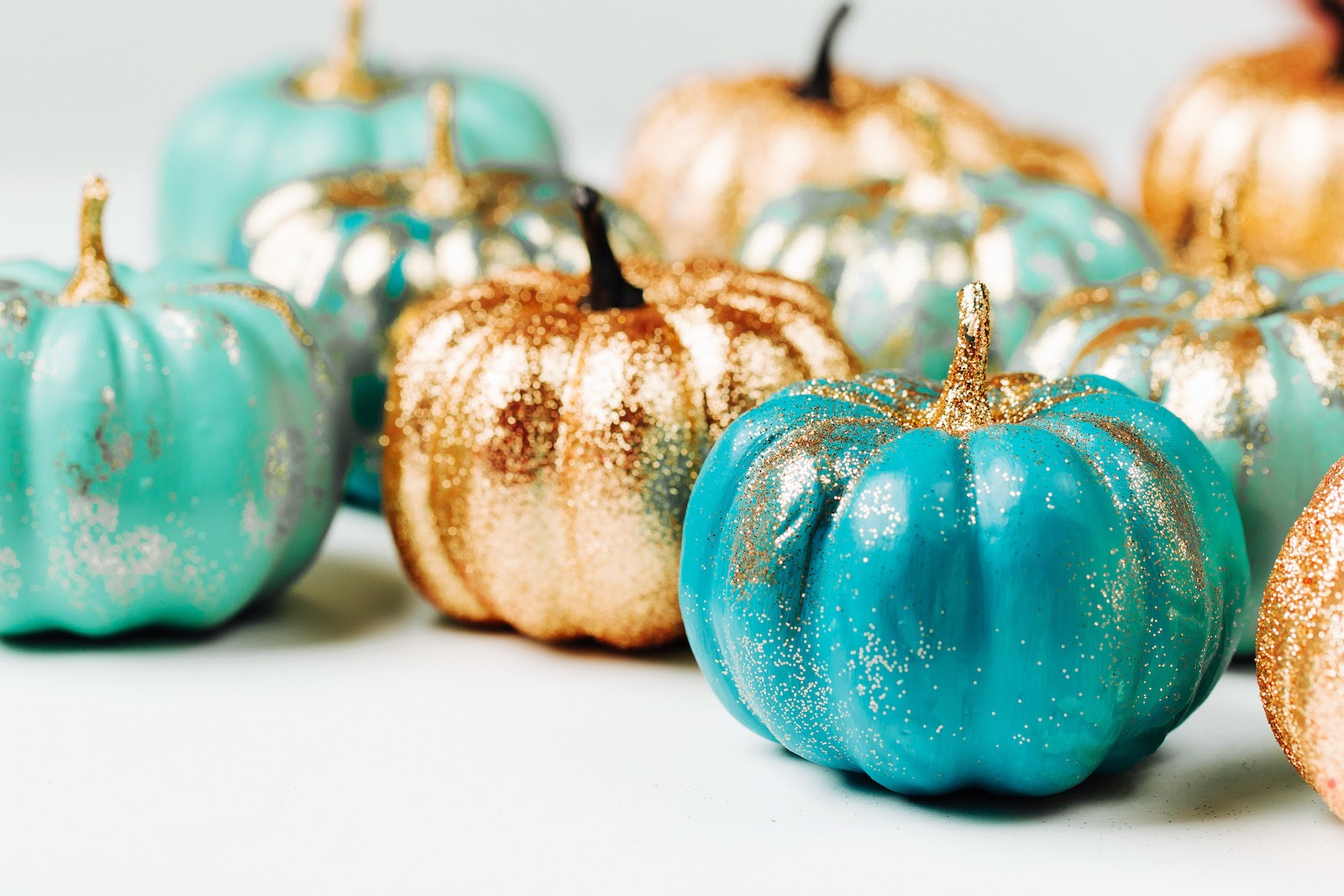Thanksgiving decoration ideas for pops of color with painted pumpkins.