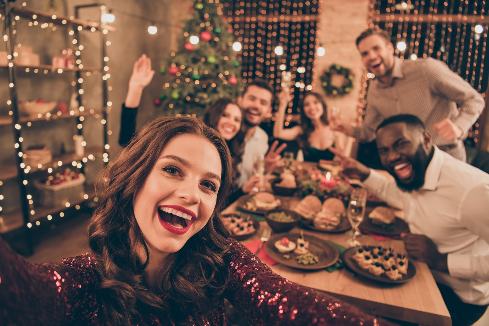 Christmas party food ideas: Guests take a selfie at a Christmas dinner party