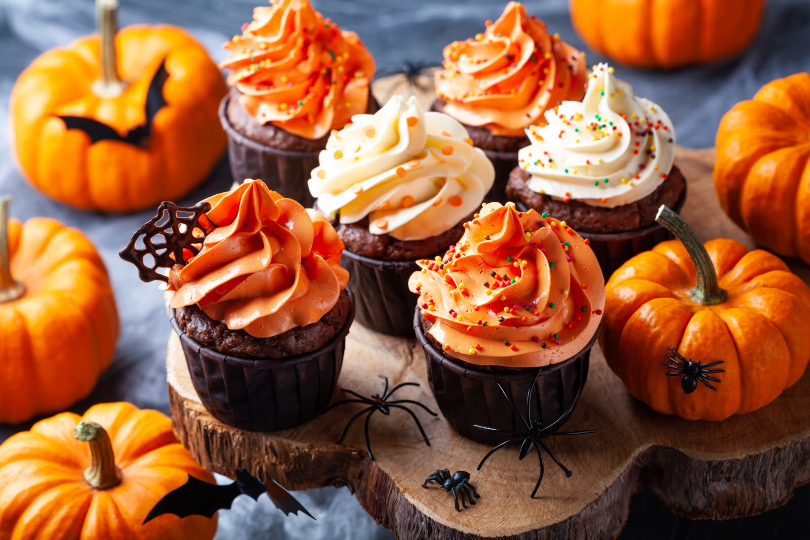 Decorative Halloween themed cupcakes are ready to be eaten by partygoers.
