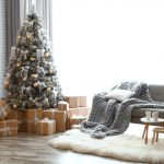 Christmas decorating ideas: A white, gold, and grey Christmas tree in a contemporary living room