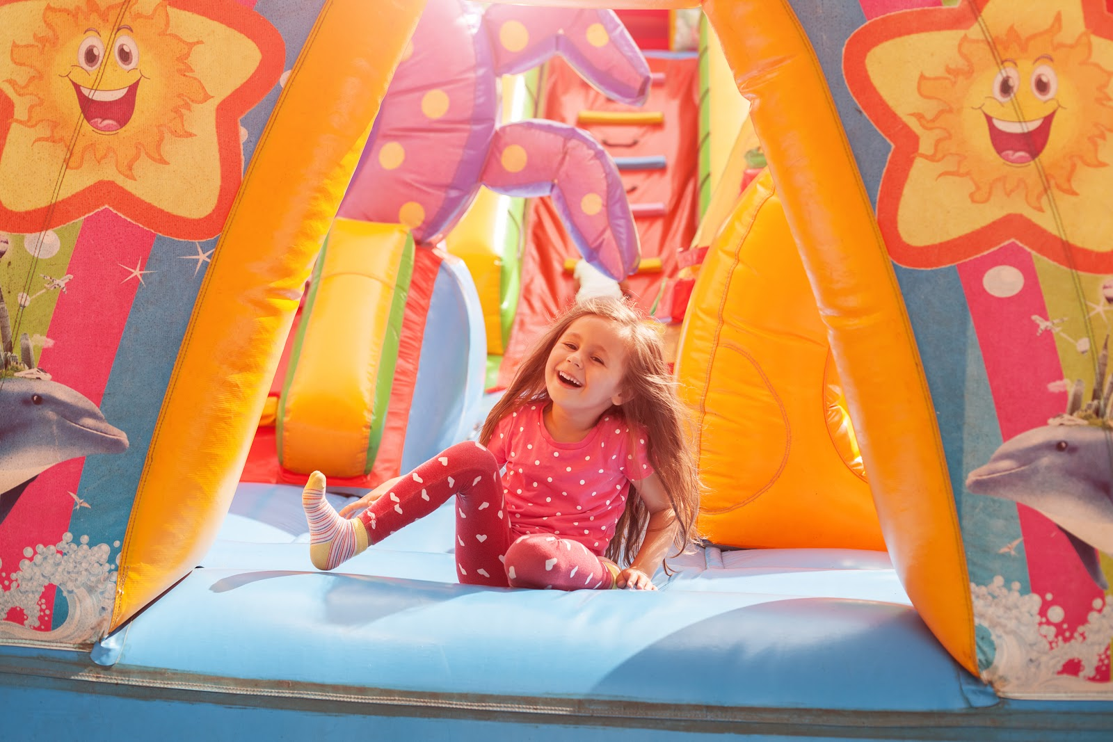 Party games for kids: Child playing in inflatable tent