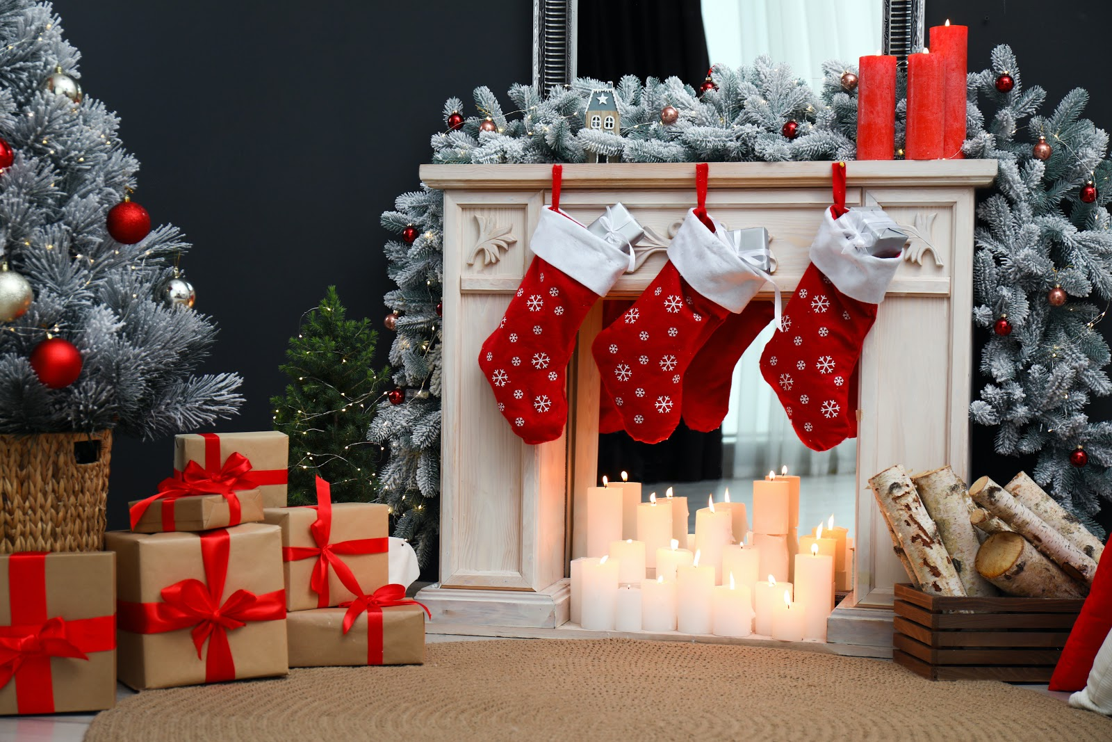 Christmas decorating ideas: A DIY fireplace made with a mirror, wooden mantel, and candles