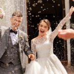 A couple gets rice thrown at them on their wedding day
