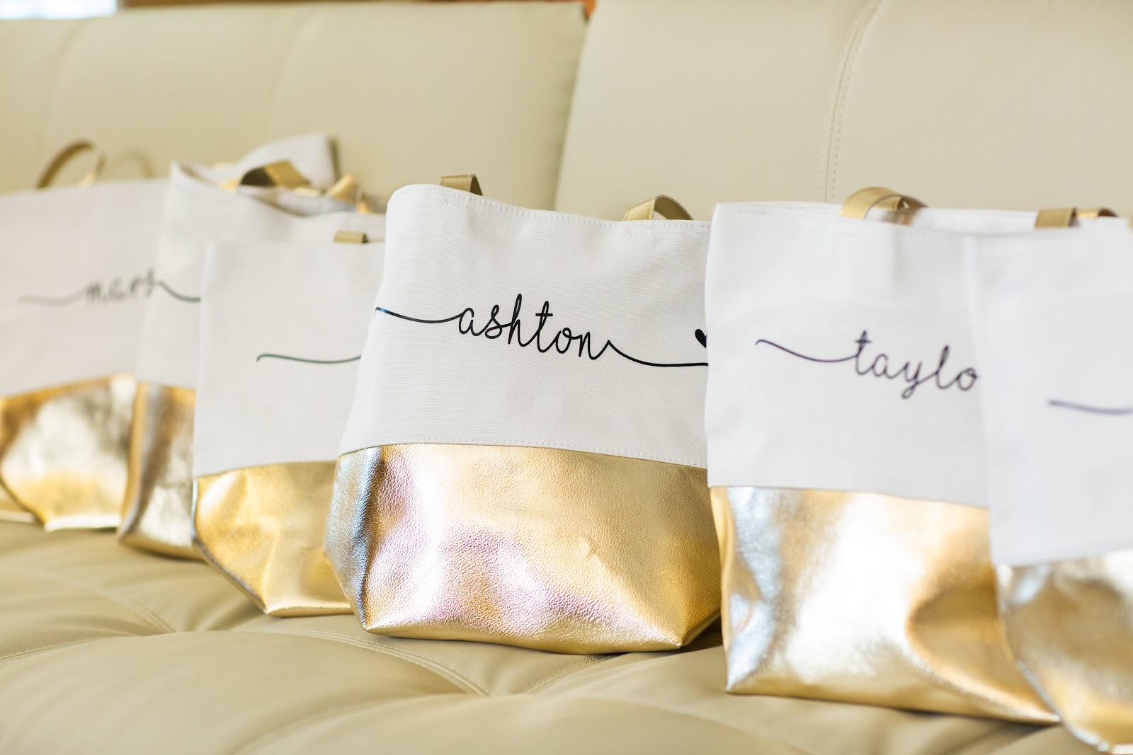 bridesmaid proposal ideas: Monogrammed tote bags on a couch