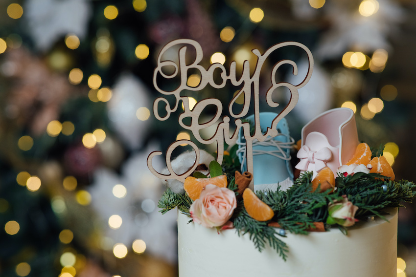 """A baby shower cake with a cake topper that reads """"Boy or Girl"""""""