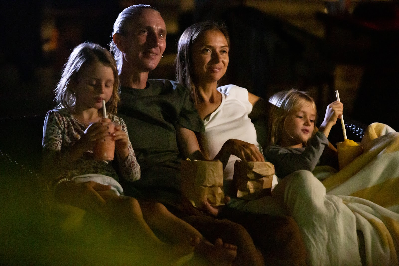Family having an outdoor movie night