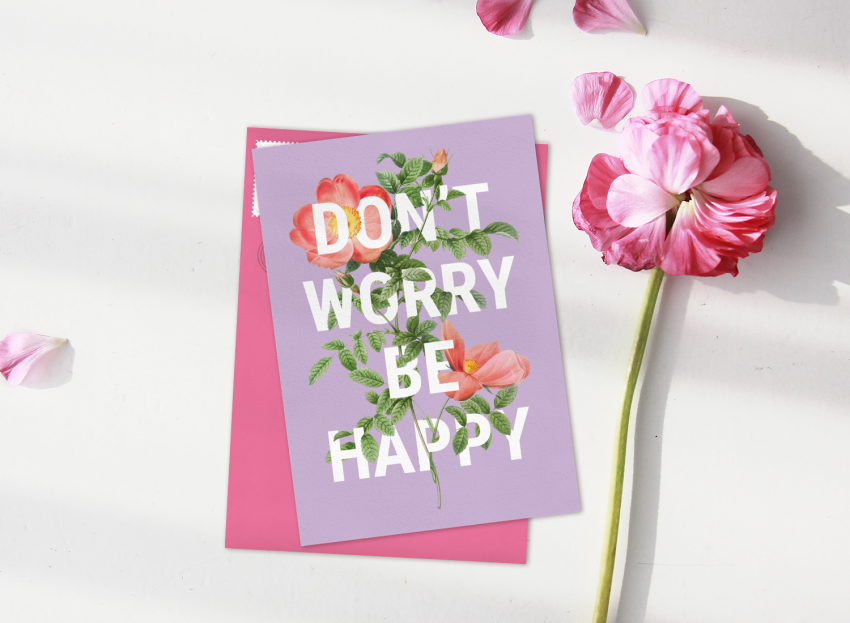 "Just Because card featuring pink florals and bold typography that reads ""Don't Worry Be Happy"""