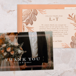 Two wedding thank you cards on a stone backdrop