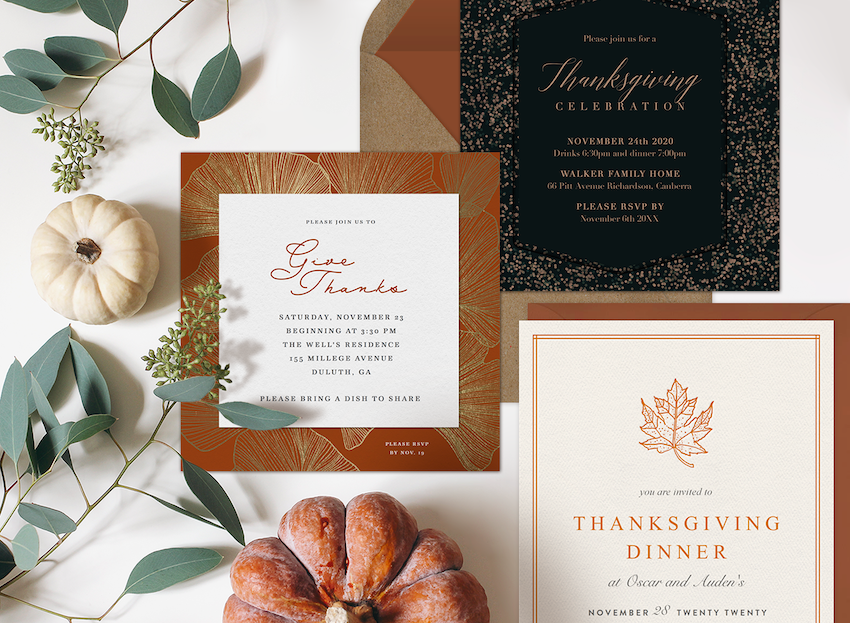 Three thanksgiving invitations surrounded by mini pumpkins and greenery