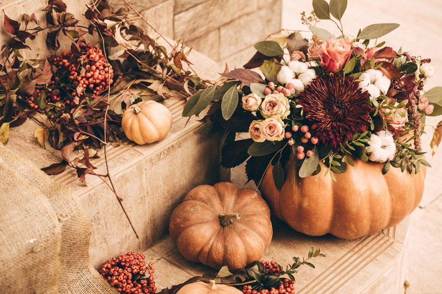 fall wedding decorations: pumpkins with floral arrangements