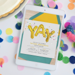 A tablet displaying a digital birthday invitation, surrounded by confetti, rock candy, and cake