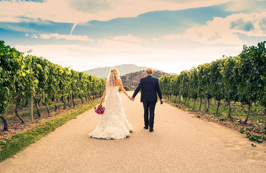 destination wedding ideas: bride and groom walking