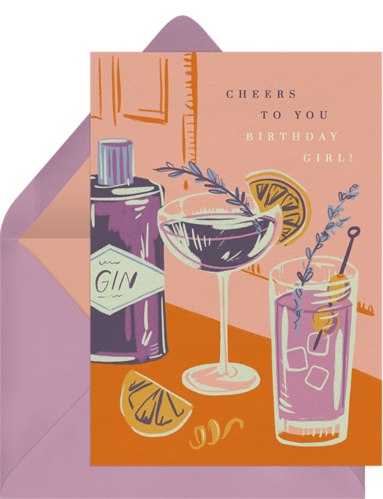 """Birthday card reading """"Cheers to you birthday girl"""" with a hand-illustrated background featuring two fancy, fun cocktails."""