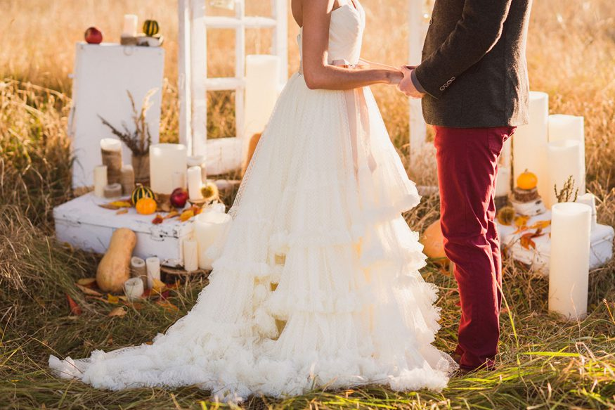 fall wedding ideas: couple in outdoor wedding setting