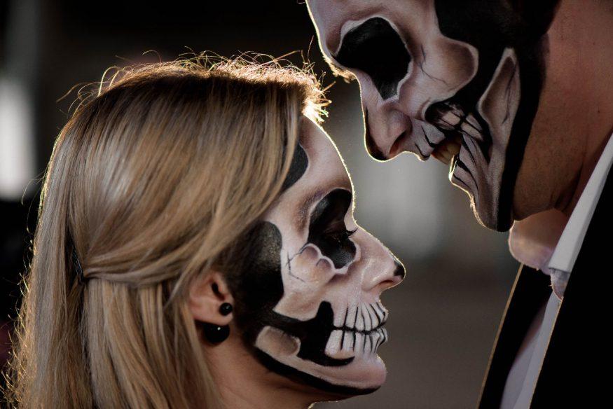 Halloween wedding ideas: couple with skull face paint
