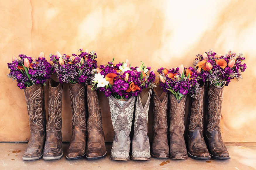 fall wedding decorations: cowboy boots with flowers