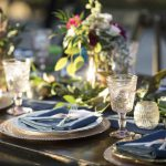 Event planning: Vintage place settings with flower arrangements on a dining table