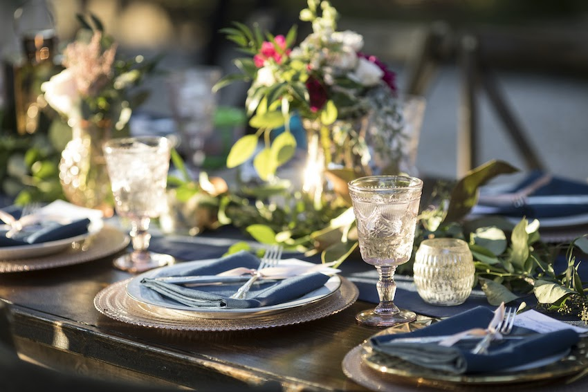 Event planning: Vintage place settings and floral arrangements on a dining table