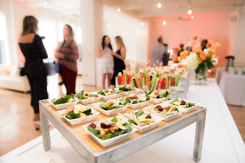 Event planning: A gallery event with small plates of food