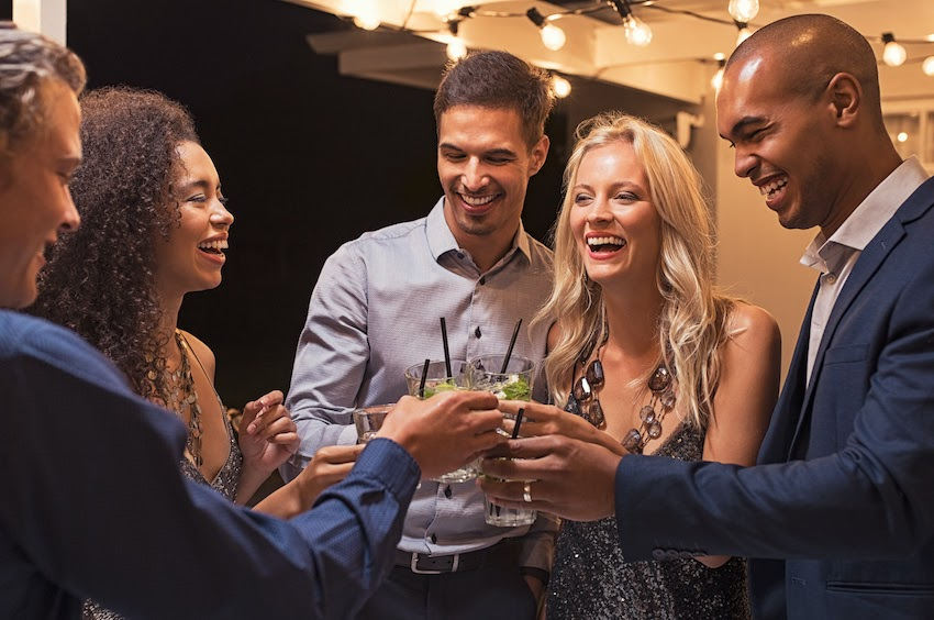 Event planning: A group of attendees raising their glasses