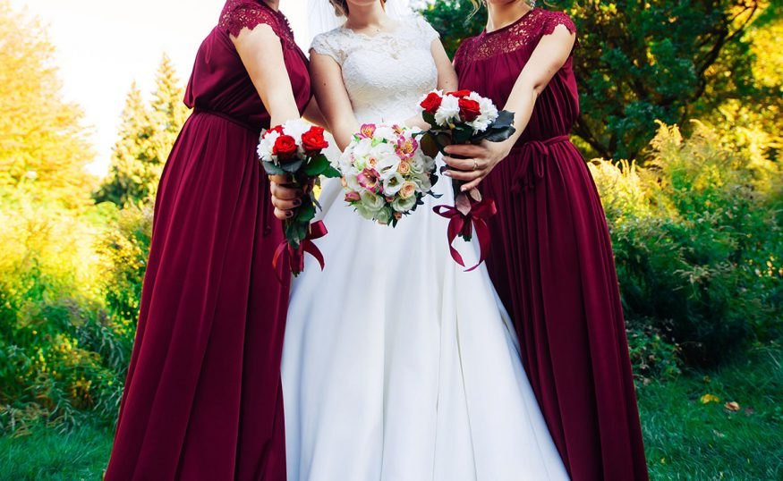fall wedding decorations: the bride with her bridesmaids holding bouquets
