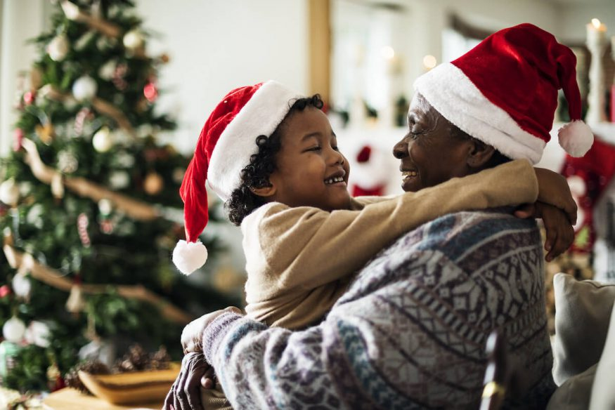 Happy holidays quotes: father and son wearing Santa hats