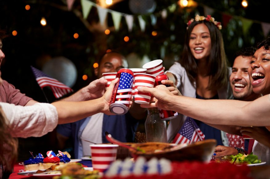 groups of friends toasting at a 4th of July party