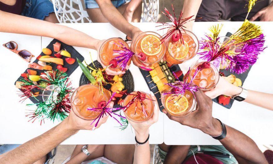 luau party: friends toasting at a luau
