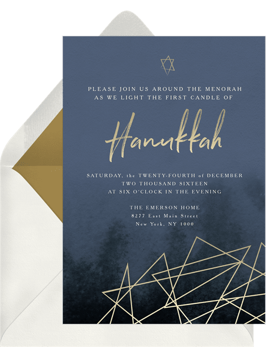 A holiday party invitation with gold-foil Star of David illustrations