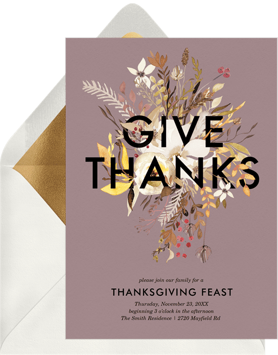 """A Thanksgiving invitation with flowers emerging from """"Give Thanks"""" text"""