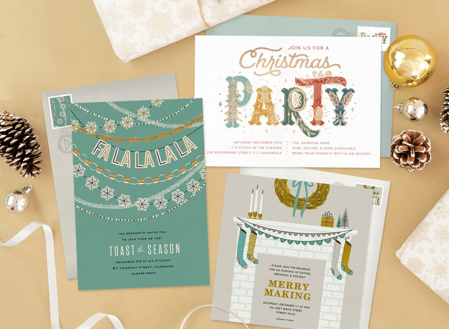 Three holiday party invitations surrounded by ornaments, pine cones, and presents
