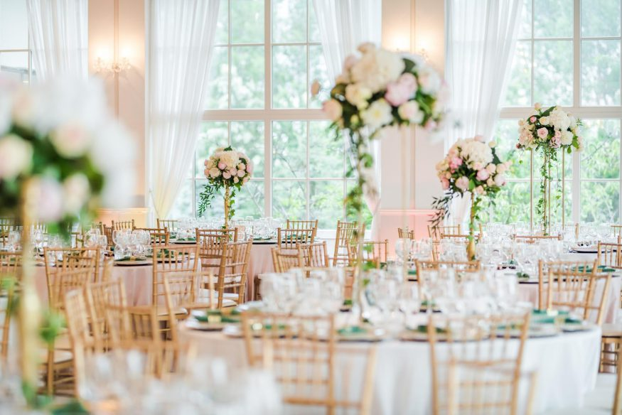 questions to ask wedding venue: Elegant wedding reception table arrangement with pink and white floral centerpieces