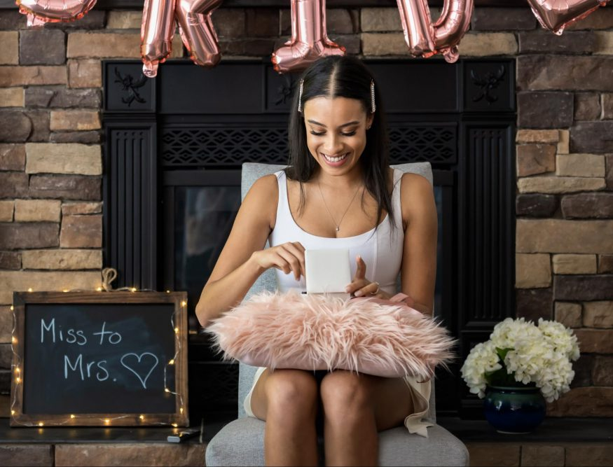 bridal shower gifts: Woman opening a gift at her bridal shower