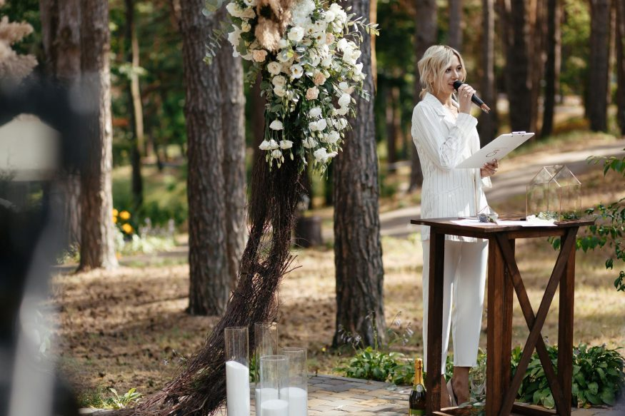 wedding poems: Woman wearing white doing a speech during wedding ceremony