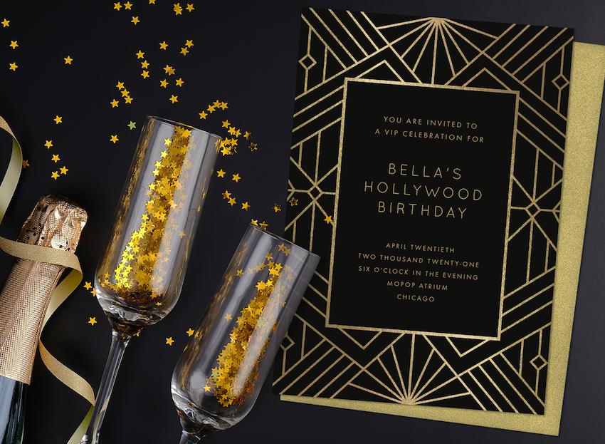 Hollywood theme party: Gold and black champagne, glasses and invitation