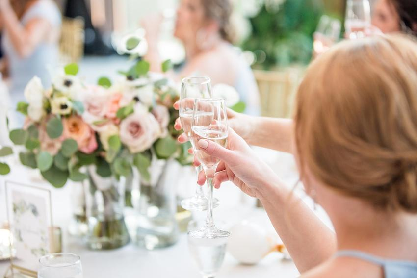 wedding congratulations: woman holding a champagne glass