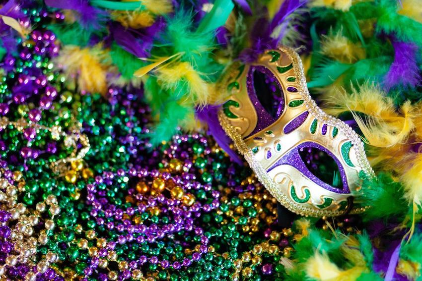 Masquerade party: Gold mask on purple and green beads